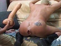 A huge dildo leaves this slaves ass gaping