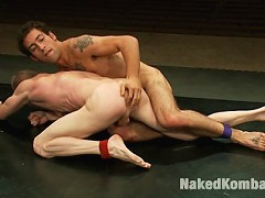 Two crazy ripped studs battle it out on the mat to save their hot asses from getting pounded by the winners huge cock.