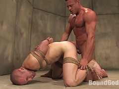 Tyler Saint ties up and fucks Christian Owen in a padded cell.